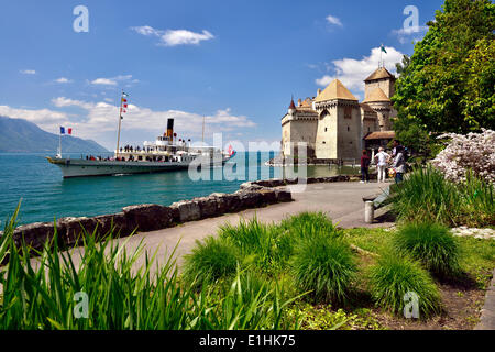 Steamship on Lake Geneva, Château de Chillon or Chillon Castle at the back, near Montreux, Veytaux, Canton of Vaud, - Stock Photo