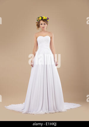 Espousal. Bride Fashion Model with Wreath of Flowers in White Dress - Stock Photo