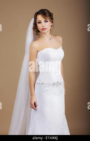 Attractive Bride in White Dress and Veil - Stock Photo