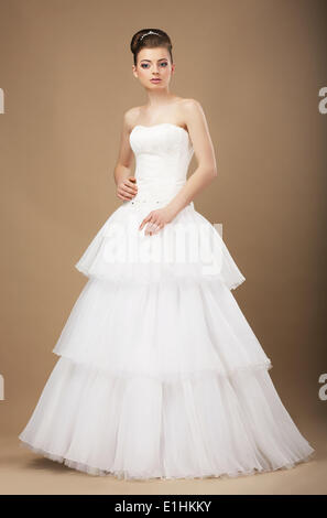 Caucasian Woman in White Long Dress Posing in Studio - Stock Photo