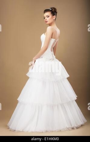 Full Length Portrait of Graceful Bide in White Wedding Dress - Stock Photo