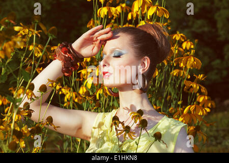 Relax. Daydreaming Woman over Floral Background with Flowers - Stock Photo