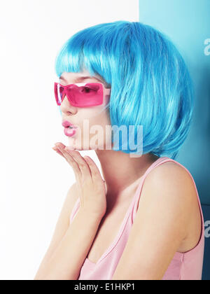 Manga Style. Profile of Charismatic Woman in Blue Wig Blowing a Kiss - Stock Photo