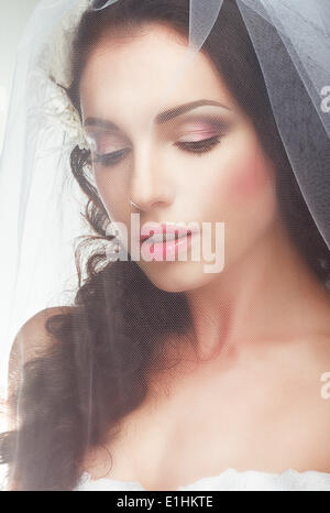 Wedding. Engagement.  Sentimental Likable Bride in Transparent Voile - Stock Photo
