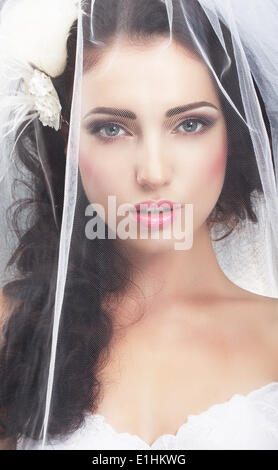 Delicacy. Caucasian Woman Hidden behind Traditional Bridal Veil - Stock Photo