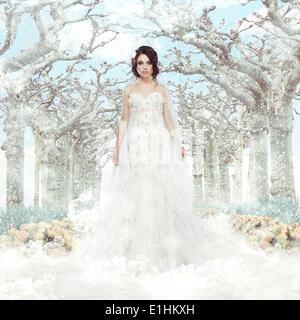 Fantasy. Matrimony. Bride in White Dress over Frozen Winter Trees and Snowflakes - Stock Photo