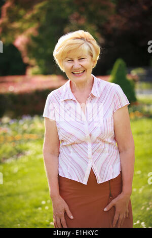 Elegance. Elation. Happy Senior Woman Outside with Toothy Smile - Stock Photo