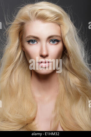 Pure Beauty. Portrait of Young Blonde with Healthy Flowing Hair - Stock Photo