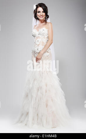 Wedding Style. Sophisticated Newlywed in White Bridal Dress. Elegance - Stock Photo