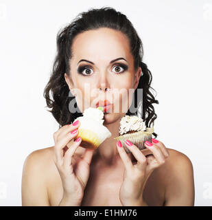 Gluttony. Hungry Funny Young Woman Greedily Eat Cakes with Cream - Stock Photo