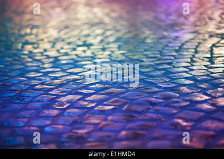 Cobble Stone Pavement - Reflexion in Urban Night. Wet Blue Sidewalk - Stock Photo