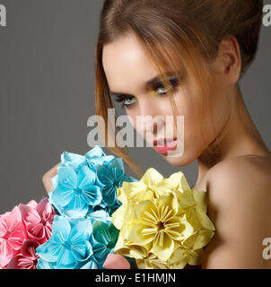 Beautiful Bright Woman holding Bouquet of Paper Origami Flowers - Stock Photo