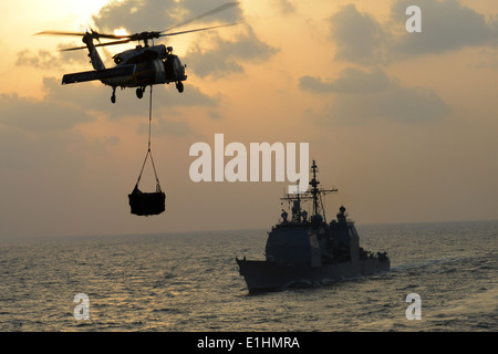 130108-N-OY799-038 U.S. 5TH FLEET AREA OF RESPONSIBILITY (Jan. 8, 2013) - An MH-60S Knighthawk from the Eightballers - Stock Photo