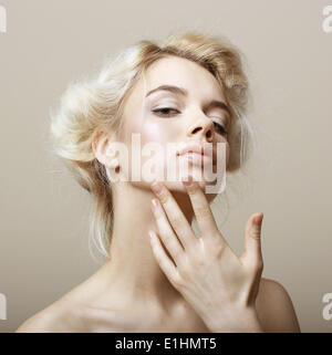 Sentimentality. Natural Blonde Woman touching her Clean Face. Pampering - Stock Photo