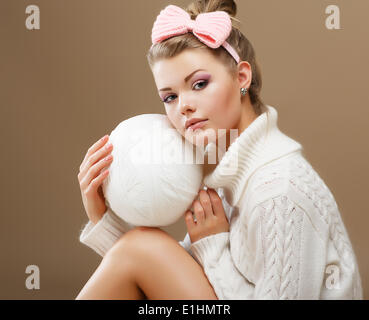 Hosiery. Beautiful Teen in Handmade Woven Sweater with White Ball of Yarn - Stock Photo
