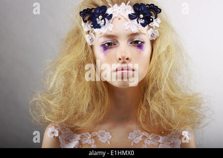 Fantasy. Portrait of Bright Blond with Unusual Makeup. Creativity