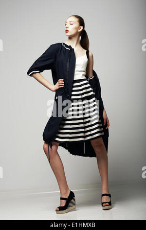 Ambitions. Confident Honorable Brunette in Black Waterproof Mackintosh. Vogue Style Stock Photo