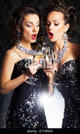 Couple of cheerful women toasting at party with wine glasses - celebration - Stock Photo