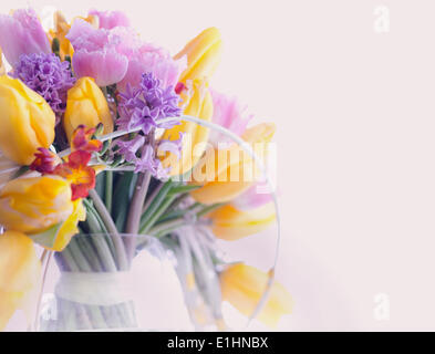 Greeting Card. Bouquet of Colorful Mixed Flowers - Tulips in a Vase. Floristics - Stock Photo