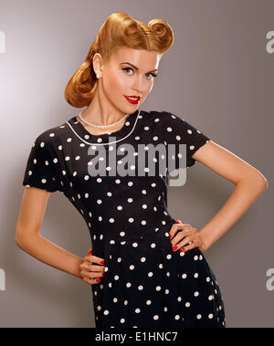 Romance. Styled Woman in Blue Retro Polka Dot Dress. Pin Up Style - Stock Photo