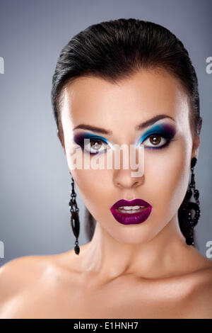 Holiday evening make-up. Styling beauty young female face - Stock Photo