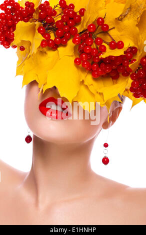Autumn beautiful female. Natural makeup. Yellow leaves and berries - Stock Photo