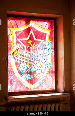 Red star, hammer and sickle, laurel wreath and sabers (swords). Heraldic composition - Stock Photo