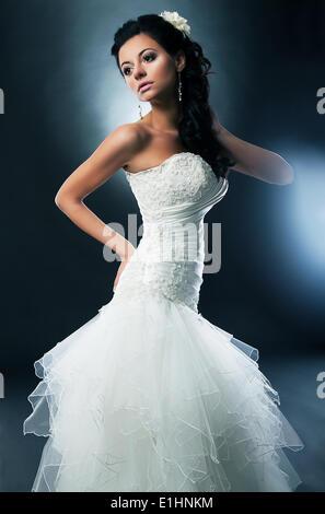 Brunette bride on a black background series of photos. Studio shot - Stock Photo