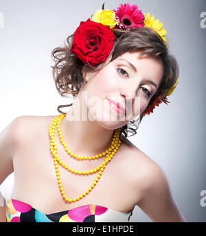 Beauty female face - happy young fashionable girl with flowers. series of photos - Stock Photo