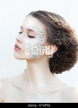 Beautiful young girl face. Perfect skin concept. Art make-up. Natural beauty - Stock Photo