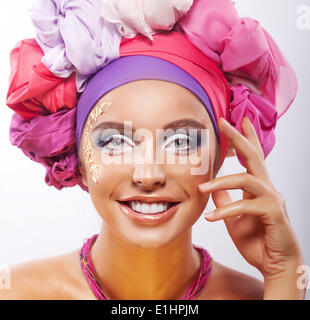 Lifestyle. Beauty. Portrait of young happy toothy smiling woman in colorful headwear - Stock Photo