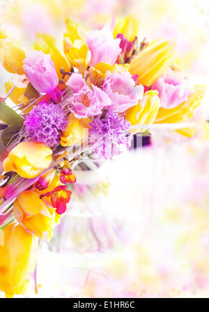 Holiday.  Beautiful spring flowers - yellow tulips as festive background - Stock Photo