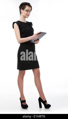 Beautiful  businesswoman in glasses holding a laptop isolated on white background - Stock Photo