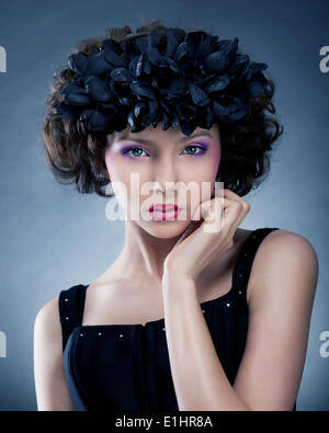 Freshness and sensuality. Beauty woman with wreath of flowers - Stock Photo