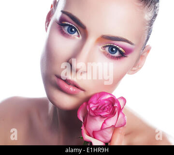 Beautiful young woman with pink rose close up beauty portrait - Stock Photo