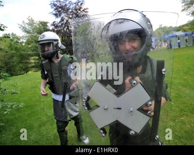 Bochum, Germany. 2nd June, 2014. Two youths wear protective police armour during a recruitment campaign of North - Stock Photo