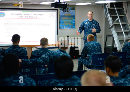130121-N-RJ456-004 U.S. 5TH FLEET AREA OF RESPONSIBILITY (Jan. 21, 2013) Master-at-Arms 1st Class Marshall Button, - Stock Photo