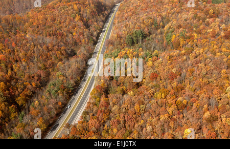 Highway between autumn colour forests near Mountaintop removal site, Wise County, Virginia, USA - Stock Photo
