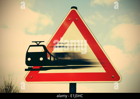 Moving train leaving sign, composite - Stock Photo
