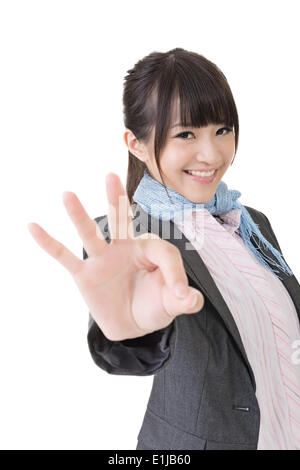 Asian business woman showing OK sign - Stock Photo