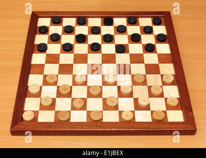 checkerboard with checkers spaced - Stock Photo