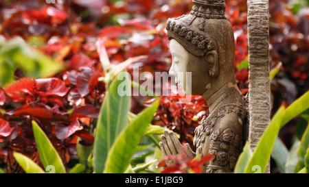 Asia, Thailand, Bangkok, Buddha figure in garden - Stock Photo