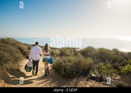 Romantic young couple strolling on coastal path, Torrey Pines, San Diego, California, USA - Stock Photo