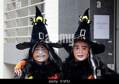 Two women parading in traditional witch costume and orange colour face paint portrait Ostend  sc 1 st  Alamy & Parading in street in traditional witch costumes with broomsticks ...
