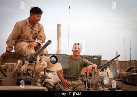 U.S. Marine Corps Lance Cpl. Phillip Lim, left, and Cpl. Brandon Baber, both assigned to Delta Company, 1st Tank - Stock Photo