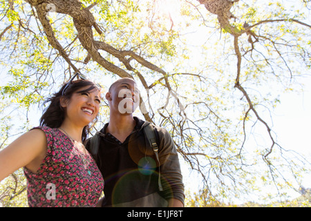 Young romantic couple in park - Stock Photo