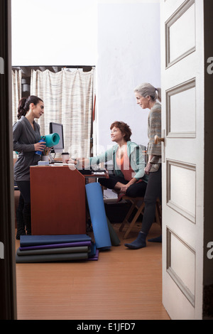 Women chatting in office - Stock Photo