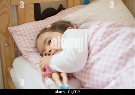 Girl at bedtime - Stock Photo