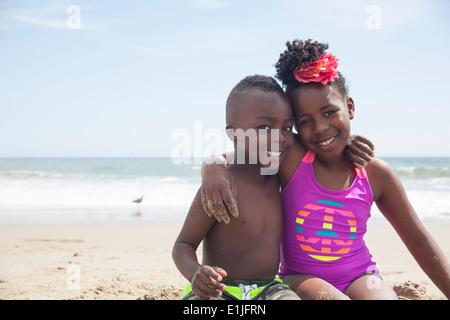 Children posing on beach - Stock Photo