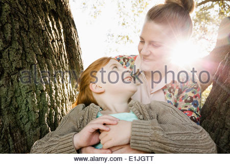 Portrait of mid adult mother and daughter in park - Stock Photo